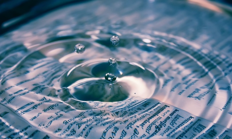Water drops over dictionary, by Janeke88