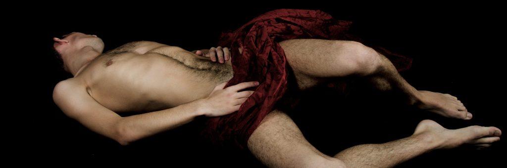 male model draped in red © vladorlov (modified)